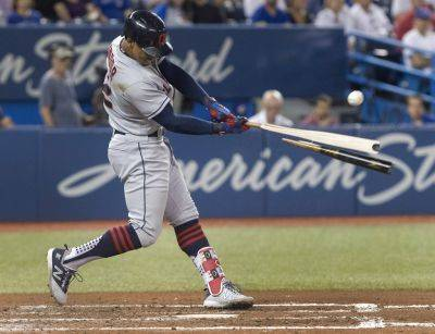 Cleveland's Francisco Lindor hits a broken-bat single to drive in two runs against the Blue Jays during the fifth inning of Thursday night's game in Toronto. (AP photo)