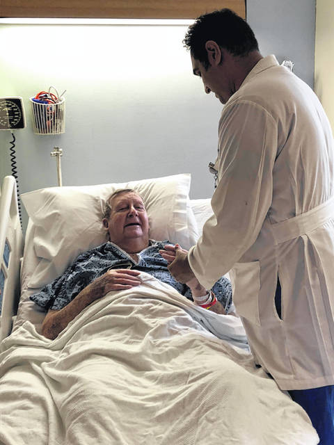 Mercy Health-St. Rita's interventional cardiologist Dr. Sandeep Patel talks to patient Dean Noffsinger after his invasive transcatheter aortic valve replacement surgery Tuesday at Mercy Health-St. Rita's Medical Center.