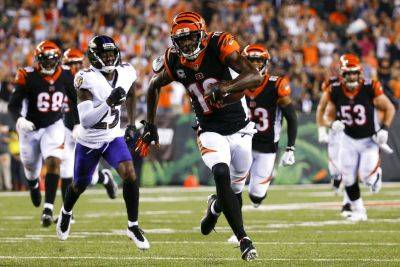The Bengals' A.J. Green (18) heads for the end zone on one of his three touchdown receptions Thursday night against Baltimore in Cincinnati. (AP photo)