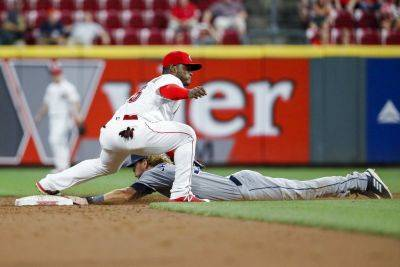 San Diego's Travis Jankowski safely slides into second with a stolen base against the Reds' Dilson Herrera during Thursday night's game in Cincinnati. (AP photo)