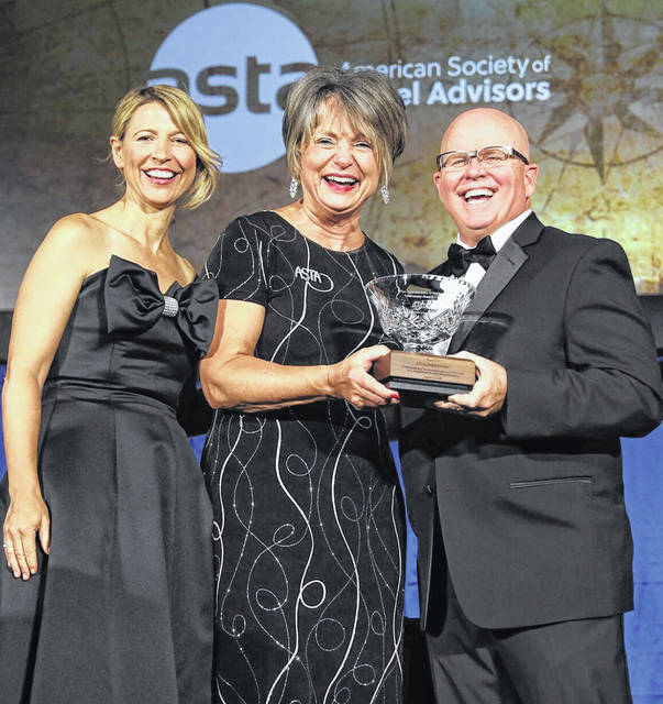 Chris Seddelmeyer of Seddelmeyer Travel Concepts of Lima, center, was honored at the recent annual meeting of the American Society of Travel Advisors. At left is Samantha Brown, who has her own travel show on several different TV channels.