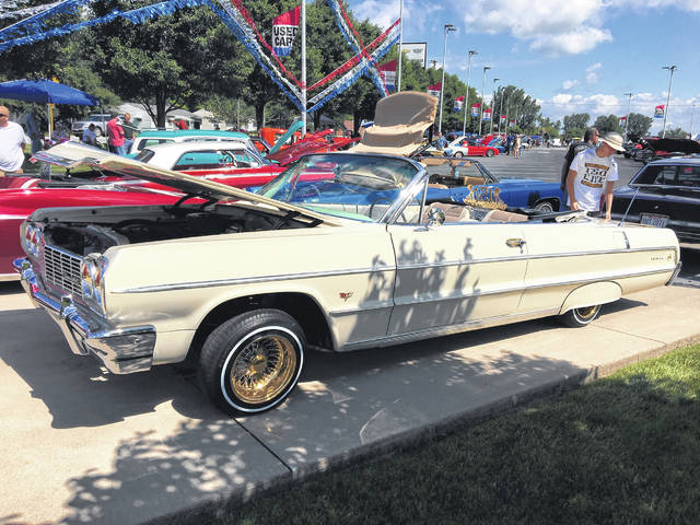 real wheels 1964 impala how low can you go the lima news 1962 Impala Lowrider pat law of lima likes the classic chevy style of his 1964